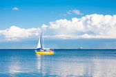 Yellow sailboat at sea — Stock Photo