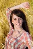 Pretty brunette in a field — Stock Photo