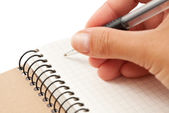 Notebook and hand with pen — Stock Photo