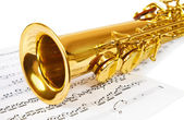 Musical notes and saxophone — Stockfoto