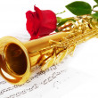 Musical notes and saxophone — Stock Photo