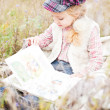 Little girl reading book — Stock Photo