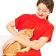 Beautiful woman in red dress with a cat — Stock Photo