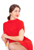 Beautiful brunette woman with red lips and dress — Stok fotoğraf