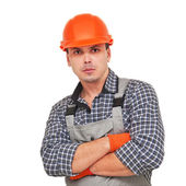 Portrait of confident worker in helmet isolated on white — Stock Photo