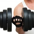 Beginning sportsman, the first steps in employment with dumbbells — Stock Photo #40597317