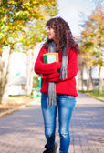 Student girl outdoor in park smiling happy — Stock Photo