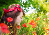 Woman on field with flowers — Foto Stock