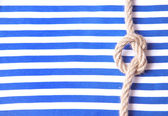 Striped cloth and a rope — Stockfoto
