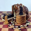 Chess, elephant and beads — Stock Photo