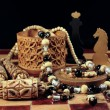 Stock Photo: Chess, box from birch bark and necklace
