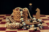 Chess, box from birch bark and a necklace — Stock Photo