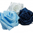 Three silk roses - Stock Photo