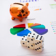 Stock Photo: Saving money. Gambling concept.Pig, coins and dices composition