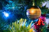 Christmas tree with christmas golden bauble — Stock Photo