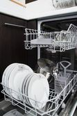 Dishwasher with white plates — Stock Photo