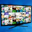 Widescreen high definition TV screen with video gallery. Televis - Stock Photo