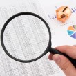 Magnifier on business background. Use for company strategic beha — Stock Photo