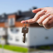 Woman's hand holding keys to new house — Stock Photo #25538373