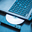Laptop with open CD - DVD drive. Abstract light composition — Stock Photo #29571117