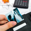 Personal credit card in wallet. Piggybank and calculator in back — Stock Photo