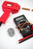 Soldering tool, multimeter on white background — Stock Photo