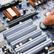 Stock fotografie: Hand install battery to PC motherboard
