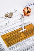 Polish income tax forms with pen, coins and piggybank — Stock Photo