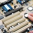 Hand install battery to PC motherboard — Stock Photo