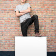 Young man holding blank whiteboard on business presentation — Stock Photo