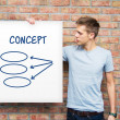 Young man holding whiteboard with diagram — Stock Photo