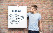 Ung man med whiteboard med diagram — Stockfoto