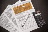 Polish tax form with pen and calculator on desk — Stock Photo