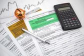 Polish income tax forms with calculator and piggybank — Stock Photo