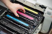 Man puts toner in the printer — Stock Photo