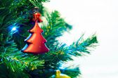 Red bauble shape of christmas tree — Stock Photo