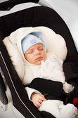 Little baby boy sleeping in car seat — Stock Photo