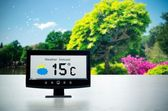 Weather station device with weather conditions outside backgroun — Stock Photo