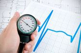Sphygmomanometer on medical background — Stock Photo