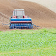 Tractor in the field — Stock Photo #17896067