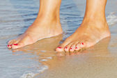 Feet in the sand — Stockfoto