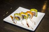 Avocado sushi rolls — Stock Photo