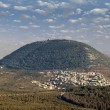 Biblical Mount Tabor and the Arab village — Stock Photo