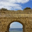 View of the Mediterranean Sea through a stone arch — Stock Photo #15411143