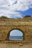 View of the Mediterranean Sea through a stone arch — Stock Photo