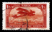 Old single-engine plane flying over Casablanca — Stock Photo