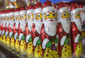 Army of chocolate Santa Clauses — Stock Photo