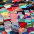 Foto Stock: Fabric store with rolls of colorful textiles