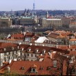 View over the red roofs in historic Prague - Stock Photo