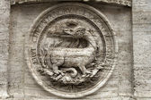 Bas-relief of a fire-breathing dragon — Stock Photo